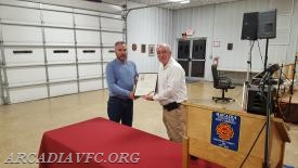 Doug Rill accepting John Rill's Citation for his 69 years of service and 100th birthday